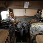 Picture of poor farmer in a trailer