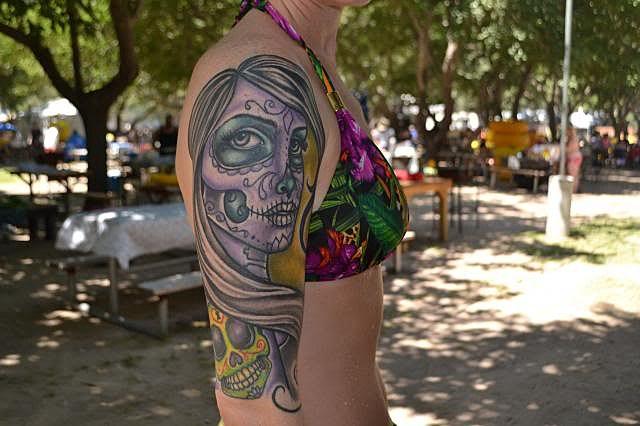 Tattoo artists filmed in slow motion